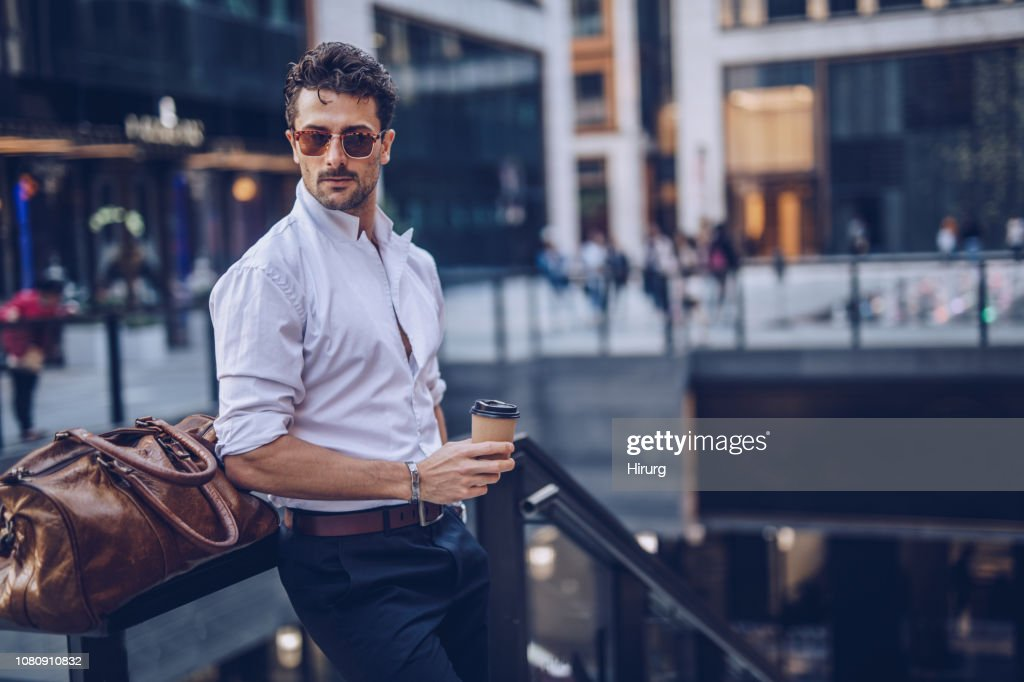 Young stylish businessman having takeaway coffee : Stock Photo