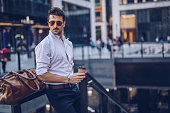 Young stylish businessman having takeaway coffee