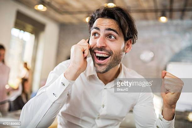 Young successful businessman talking on the phone.