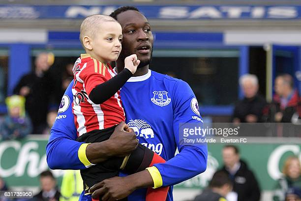 Young Sunderland fan Bradley Lowery is brought onto the pitch by Romelu Lukaku before the Barclays Premier League match between Everton and...