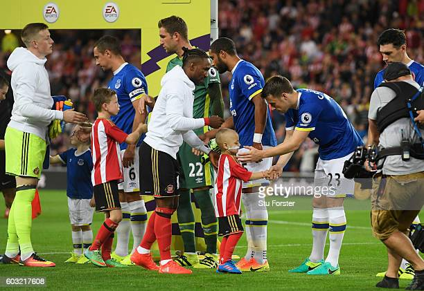 Young Sunderland mascot Bradley Lowery shakes hands with Everton player Seamus Coleman prior to the Premier League match between Sunderland and...