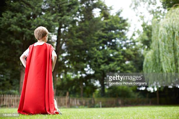 young superhero searches for danger - superhero stock pictures, royalty-free photos & images