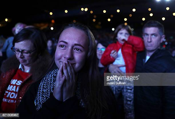 A young supporter cries as Democratic presidential nominee former Secretary of State Hillary Clinton speaks during a getoutthevote concert featuring...