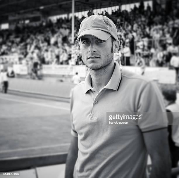 Young supporter inside a stadium - tilt shift lens