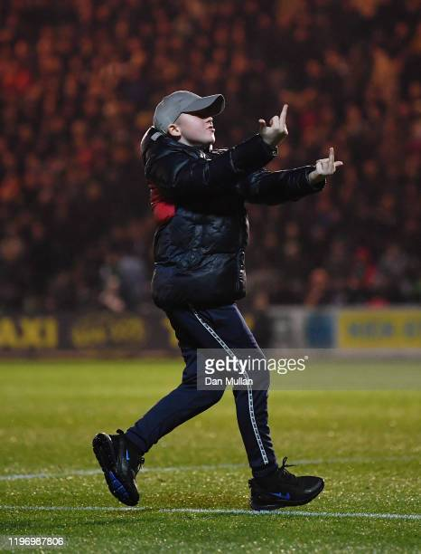 Young supporter invades the pitch and swears at the opposing fans during the Sky Bet League Two match between Plymouth Argyle and Swindon Town at...