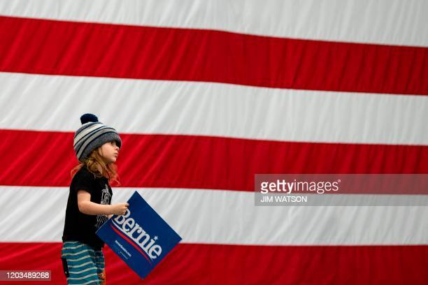 A young supporter of Democratic presidential candidate Bernie Sanders holds a placard during a rally inMyrtle Beach South Carolina on February 26 2020