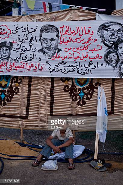 A young supporter of deposed Egyptian President Mohammed Morsi waits prior to the 'iftar' fastbreaking meal at a sitin protest at the Rabaa al Adweya...