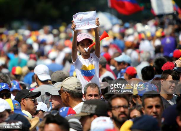 A young supporter of Juan Guaido shows a sign during the May 1 demonstration at plaza Altamira on May 1 2019 in Caracas Venezuela Yesterday...