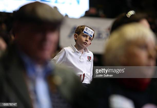 A young supporter of Republican presidential candidate former Massachusetts Gov Mitt Romney looks on during a campaign rally at George Mason...