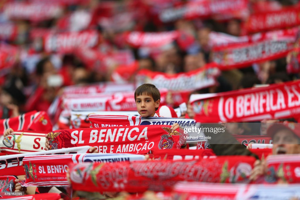 A young supporter of SL Benfica looks on amongst a forest of scarves during the UEFA Europa League Round of 16 2nd leg match between SL Benfica and Tottenham Hotspur at Estadio da Luz on March 20, 2014 in Lisbon, Portugal.
