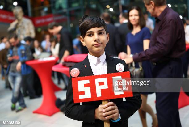 A young supporter of the German Social Democrats looks on before initial results come in for the German federal elections on September 24 2017 in...