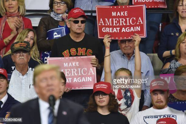 A young supporter of US President Donald Trump holds up a sign as he speaks during a Make America Great Again rally in Billings Montana on September...