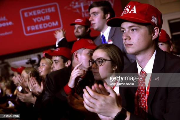 Young supporters cheer as US President Donald Trump addresses the Conservative Political Action Conference at the Gaylord National Resort and...