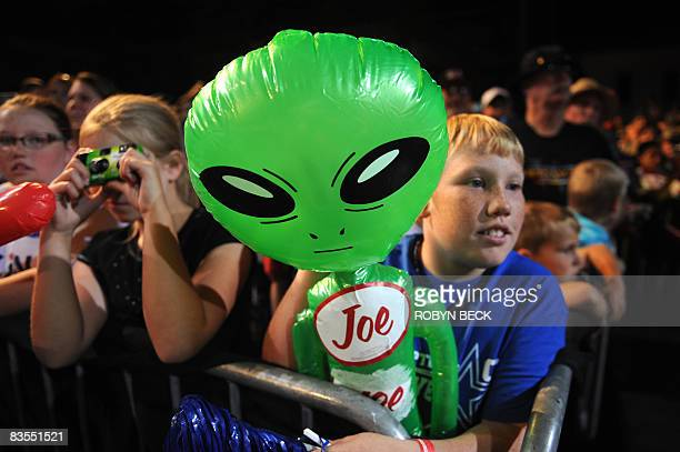 Young supporters hold inflatable alien dolls with Joe stickers on them as Republican presidential candidate John McCain addresses a campaign rally at...