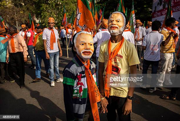 Young supporters of Bharatiya Janata Party leader Narendra Modi wear masks showing his image before Modi filed his nomination papers on April 9 2014...