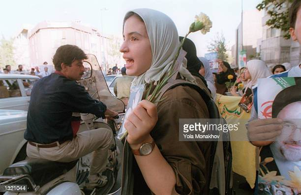 Young supporters of incumbent Iranian President Mohammed Khatami celebrate his expected election victory June 9, 2001 at a rally in Tehran, Iran.