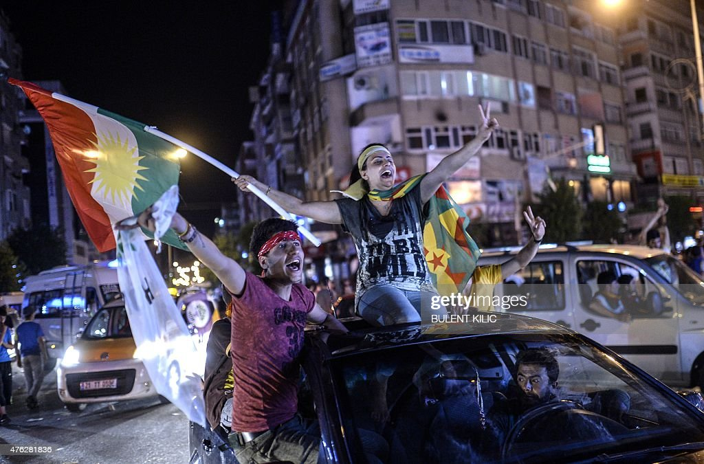 Young supporters of pro-Kurdish Peoples' Democratic Party (HDP) hold Kurdish flags as they celebrate the results of the legislative election, in Diyarbakir on June 7, 2015. The HDP easily surpassed the 10 percent barrier needed to send MPs to parliament. Under Turkey's proportional representation system, this means the Turkey's Islamic-rooted Justice and Development Party (AKP) will need to form a coalition for the first time since it first came to power in 2002.