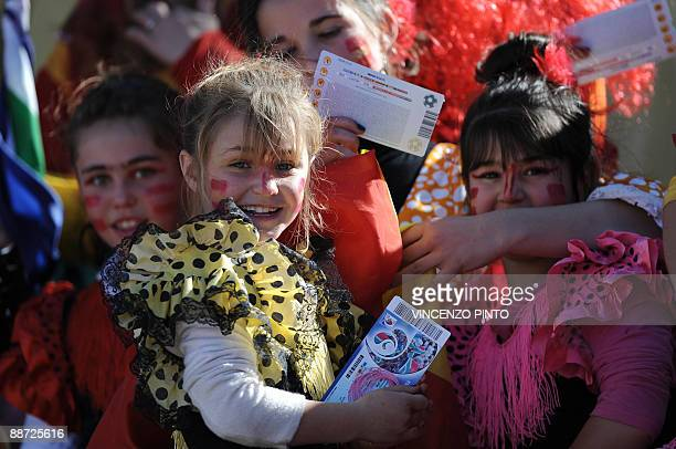 Young supporters of Spain wearing flamenco style outfits hold their tickets in the stand before the Fifa Confederations Cup third place playoff...