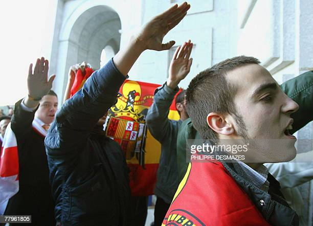 Young supporters of Spanish dictator Francisco Franco give the fascist salute 17 November 2007 in front of the basilica of Santa Cruz at the Valley...