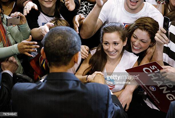 Young supporters surge forward for the chance to shake hands with Sen Barack Obama during a rally in the Bender Arena at American University January...