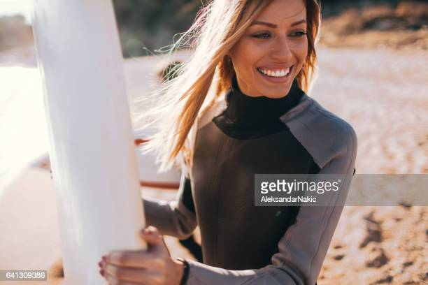 Young surfer girl and her surfboard