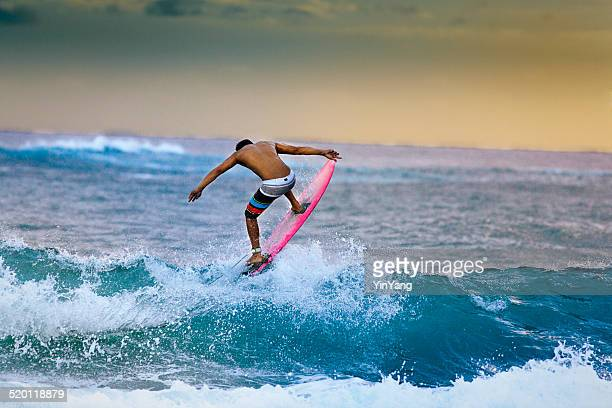 Young Surfer Surfing in the Beach of Kauai Hawaii