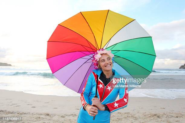 A young surfer wears bright clothes and flowers in her hair in solidarity with OneWave at Bondi Beach on March 22 2019 in Sydney Australia Surfers...