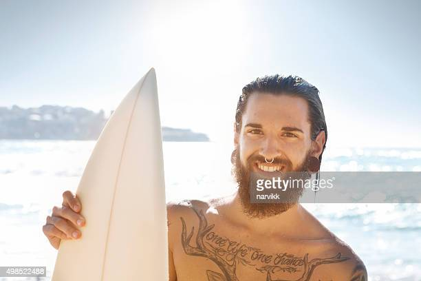 Young surfer with surfboard