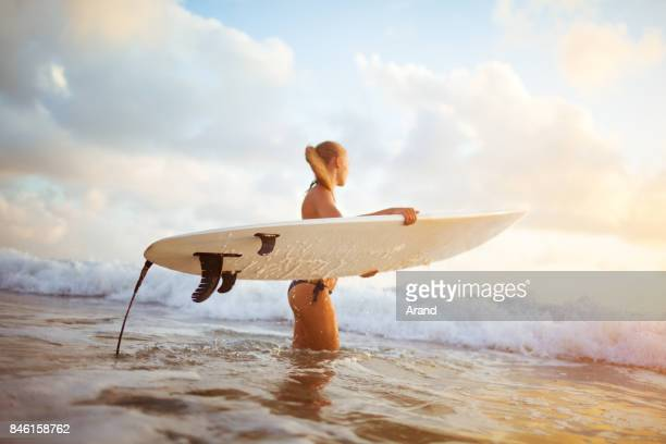 young surfer woman - hot model indonesia stock pictures, royalty-free photos & images