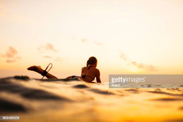 young surfer woman