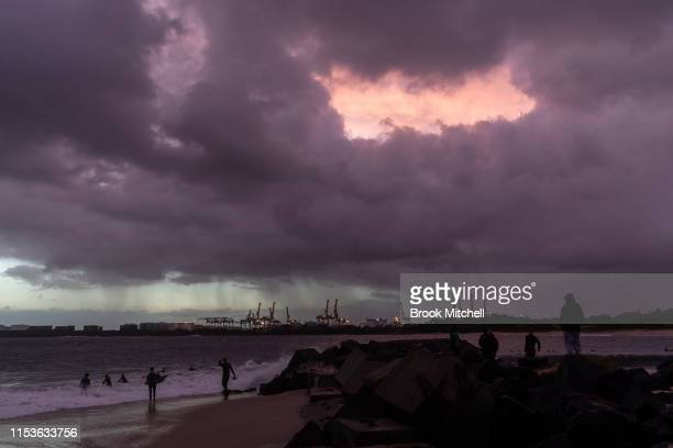 Young surfers and families enjoy rare waves breaking inside Botany Bay on June 04 2019 in Sydney Australia The Bureau of Meteorology issued a severe...