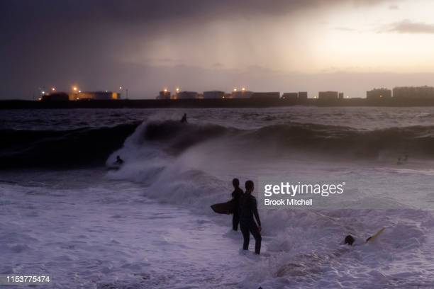 Young surfers enjoy rare waves breaking inside Botany Bay on June 04 2019 in Sydney Australia The Bureau of Meteorology issued a severe weather...