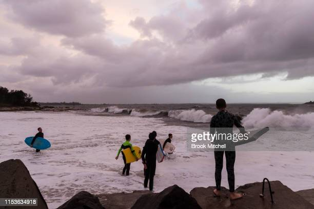 Young surfers enter the rare surf breaking inside Botany Bay on June 04 2019 in Sydney Australia The Bureau of Meteorology issued a severe weather...