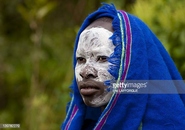 Young Suri woman with painted face in Kibbish Village Omo valley Ethiopia on July 05 2010 Surma or Suri are sedentary pastoral people living in south...