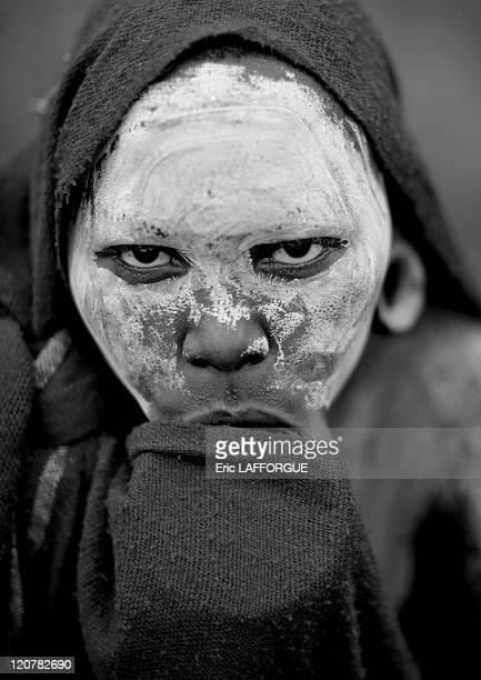 Young Surma woman hiding her lip plate under her veil in Ethiopia on July 05 2010 Woman hiding her labret because she is not married yet It means she...