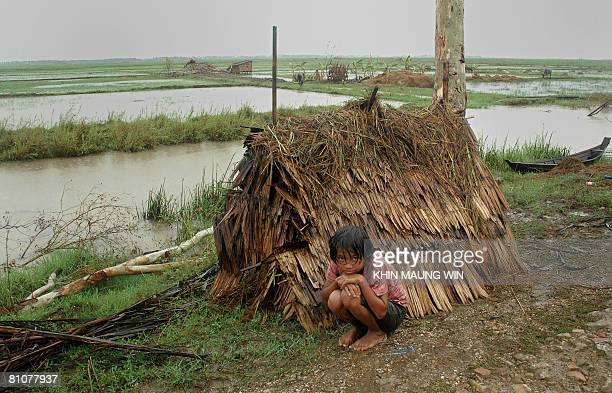 A young survivor of the cyclone Nargis wait for relief supplies in Bogalay on May 13 2008 The United Nations warned on May 13 that Myanmar faced a...