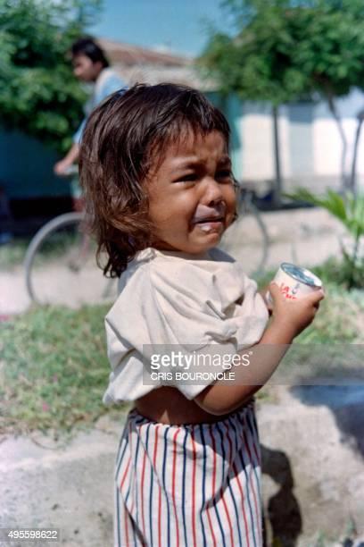 Young survivor of the volcano Nevado Del Ruiz eruption is crying, in Armero, on November 17 1985. The long-dormant Nevado del Ruiz volcano, quite...