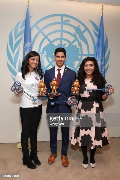 Young Sustainable Development Goals Advocates Sarina Divan Karan Jerath Noor Samee pose at the United Nations Headquarters celebrating International...