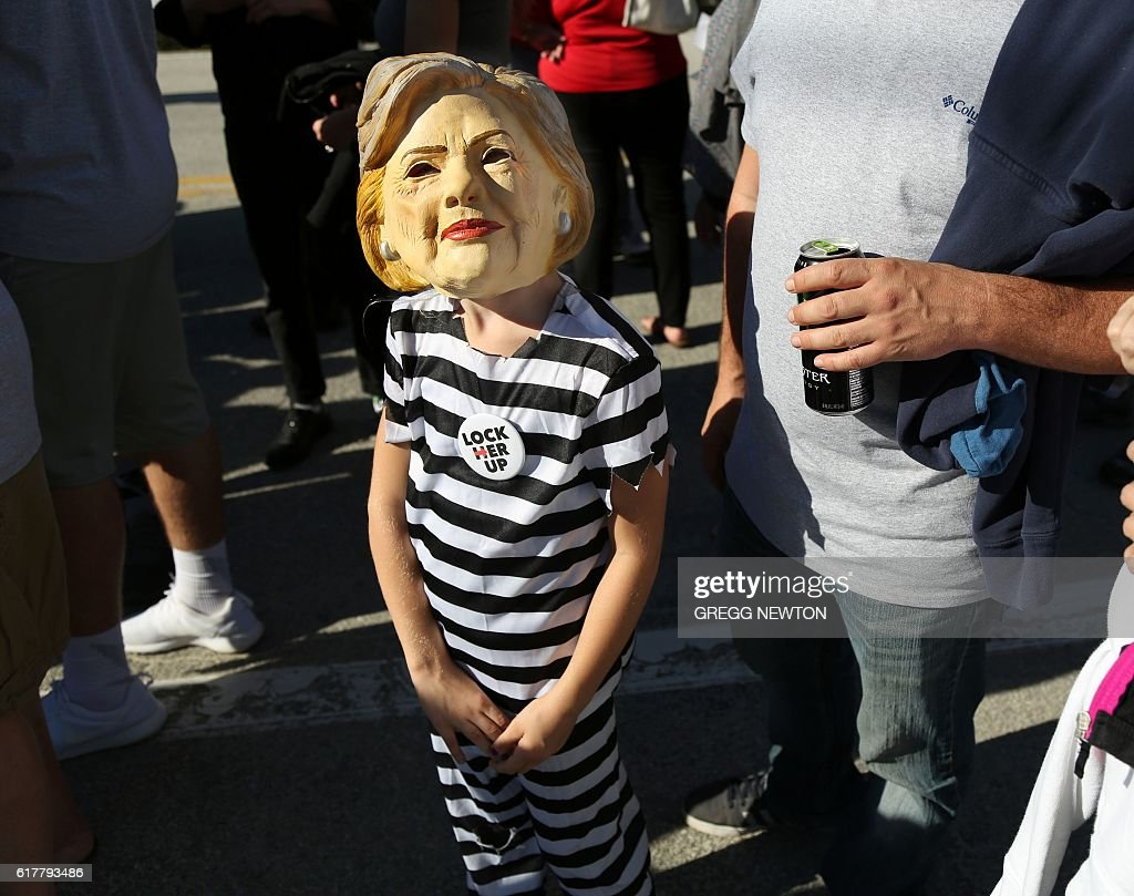 A young suupporter of Republican presidential nominee Donald Trump waits in line for a campaign event in Tampa, Florida on October 24, 2016. / AFP / Gregg Newton