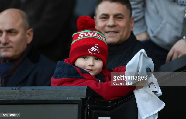 A young Swansea City fan during the Premier League match between Swansea City and AFC Bournemouth at Liberty Stadium on November 25 2017 in Swansea...