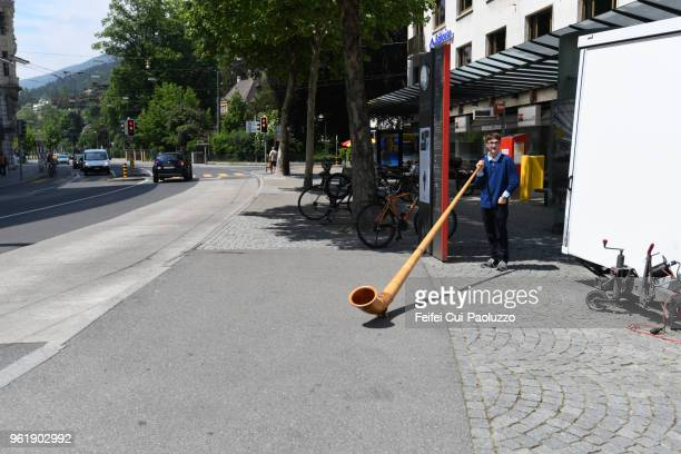 A young Swiss alphorn player at old town of Biel, Switzerland