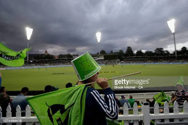 A young Sydney Thunder fan is pictured during the Sydney Thunder v Melbourne Stars Big Bash League Match at Manuka Oval on December 21 2018 in...