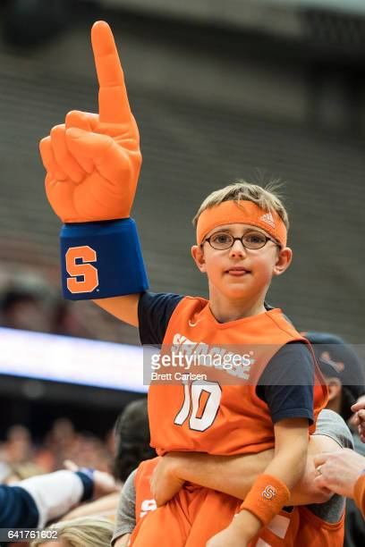 A young Syracuse Orange fan waves a foam finger as the team defeated Virginia Cavaliers on February 4 2017 at The Carrier Dome in Syracuse New York...