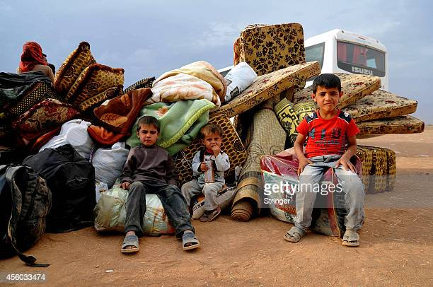Young Syrian Kurdish refugees enter Turkey at the Yumurtalik crossing gate on September 24, 2014 in Turkey. As many as 138,000 Syrian Kurds have...