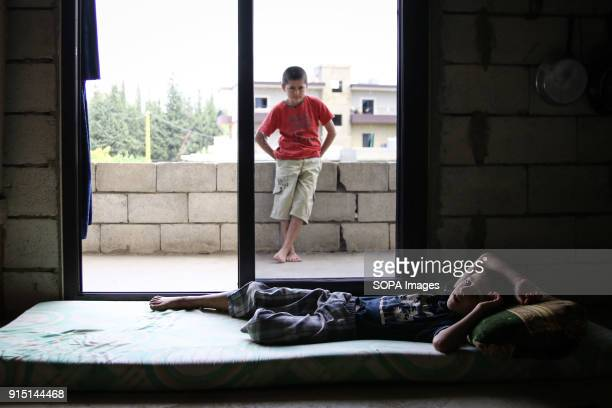 Young Syrian refugees relax at home an abandoned building in Akkar a northern and impoverished region in Lebanon The Tiny country of Lebanon is...