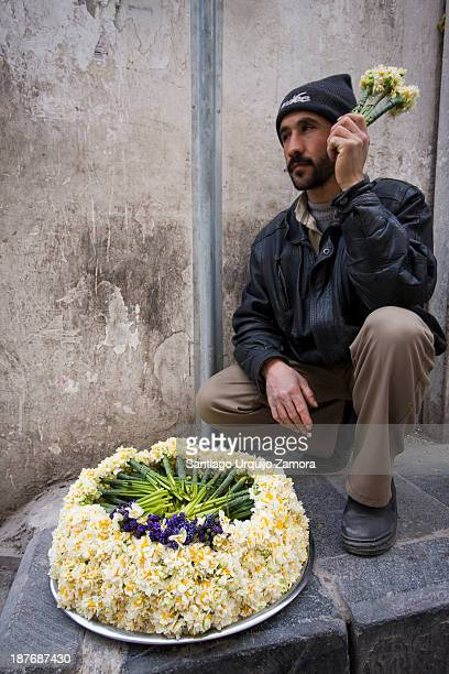Young Syrian selling flowers outside the Umayyad Mosque or the Great Mosque of Damascus, Damascus, Damascus Governorate, Syria. Syria is classified...