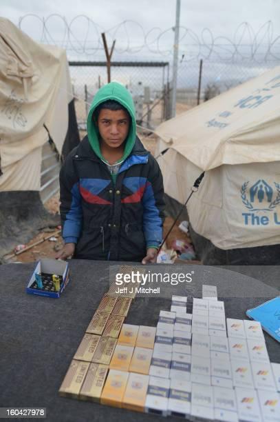 ZA'ATARI JORDAN JANUARY 31 A young Syrian sells cigarettes in the Za'atari refugee camp on January 31 2013 in Za'atari Jordan Record numbers of...