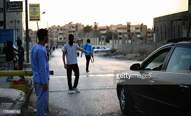 Young Syrians belonging to the socalled 'Islamist Police' made up of local citizens former opposition fighters as well as army defectors control cars...