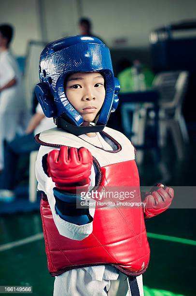 young taekwondo fighter - taekwondo kids stock photos and pictures