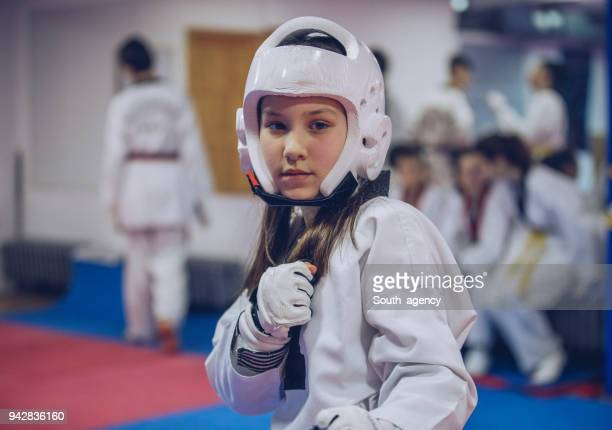 young taekwondo girl - judo stock pictures, royalty-free photos & images